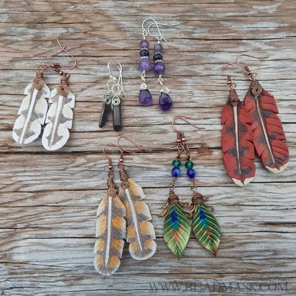 leather peacock feather earrings
