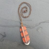 red hawk feather leather pendant