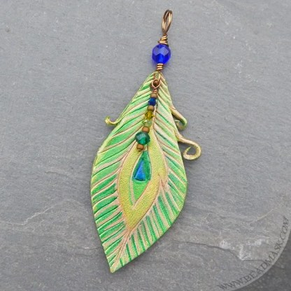 carved leather peacock feather pendant
