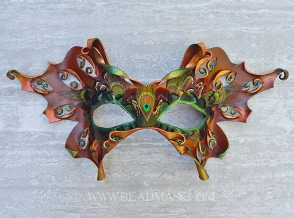 Leather moth mask with feather work accents