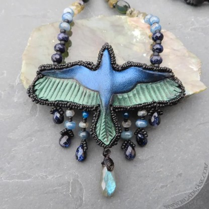leather raven necklace with iridescent gemstones