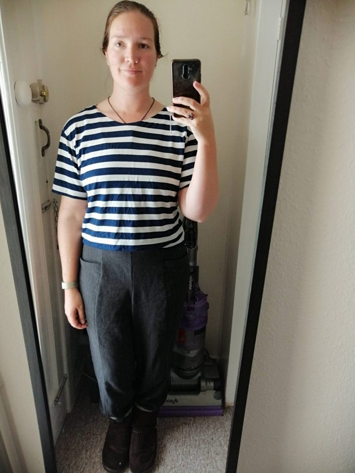 Mirror Selfie of me wearing a slightly slouchy blue and white striped t-shirt and some heathered grey wool blend trousers.