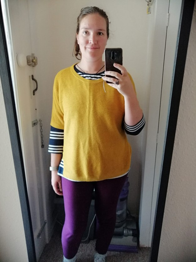 Dressed for Yoga in an oversized mustard jumper, purple leggings and a blue and white stripe tee