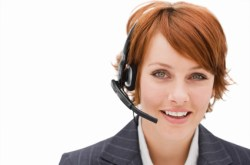 Happy young businesswoman with headset isolated over white backg
