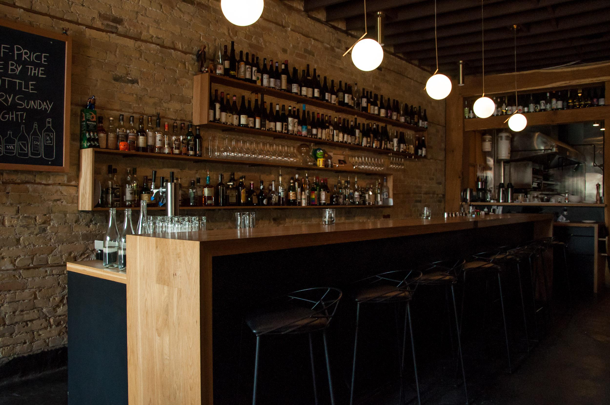 Custom bar top and back shelving made with White Oak