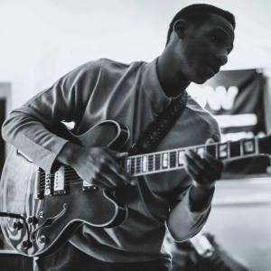 Leon Bridges Playing Guitar