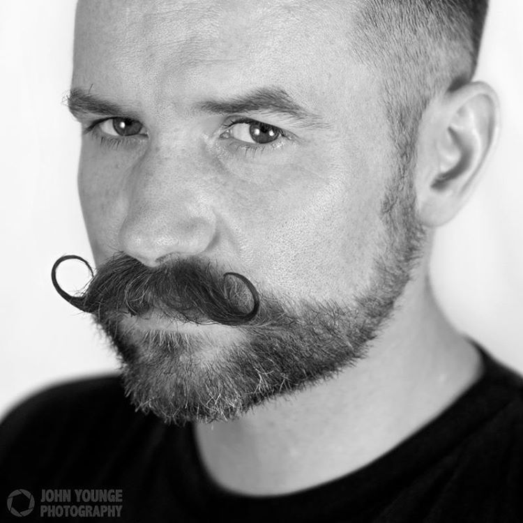 handlebar mustache with stubble men beard