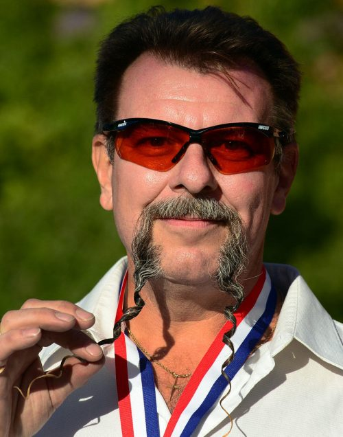 Wojo Wrzesniewski from Toronto, Canada, poses after winning first place in the Fu Manchu Moustache category at the third annual National Beard and Moustache Championships in Las Vegas, Nevada on November 11, 2012. AFP PHOTO / Frederic J. BROWNFREDERIC J. BROWN/AFP/Getty Images ORG XMIT: