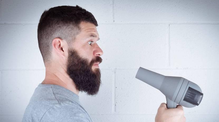 using blow dryer on beard