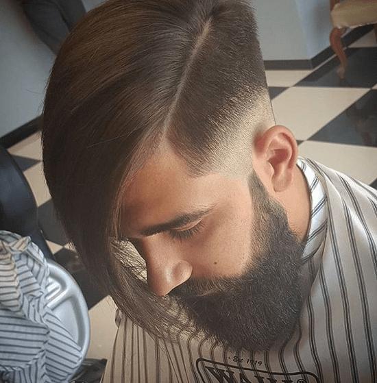 men's hair with side bangs and bushy beard