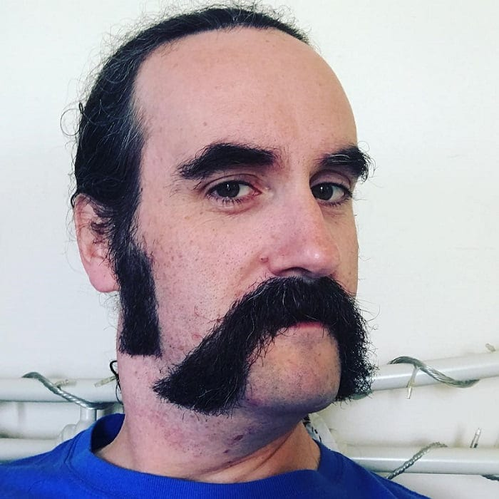 cowboy with horseshoe mustache
