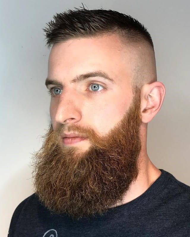 bald fade with long beard