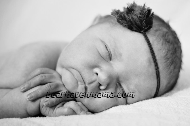 The peacefulness of the sleeping newborn was not meant to last. Picture by Photos by Emilly.