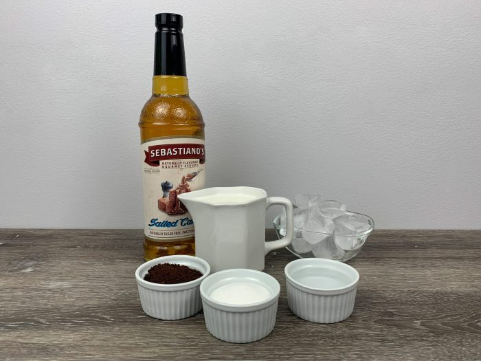 Whipped Coffee (Dalgona Coffee) combines equal parts of instant coffee, sugar, & hot water. This salted caramel version is sure to be your new fave version!