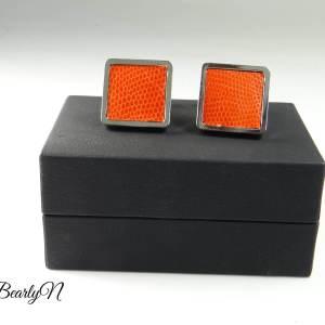 boutons de manchette lézard orange sur écrin