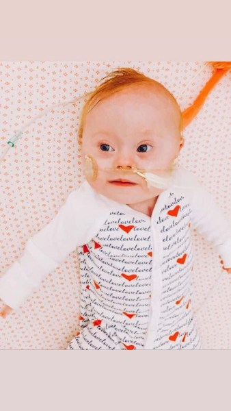 Baby with heart pajamas on. heart surgeries, Down syndrome awareness month
