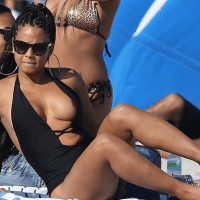 Christina Milian Takes A Trip To The Beach And Lets Her Nipple Slip [IMAGE]