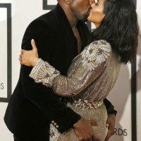 Photos: Kanye grabs Kim K's butt and kisses her at Grammy's red carpet