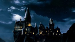 Window lights that outline the night beauty of the Hogwarts castle.