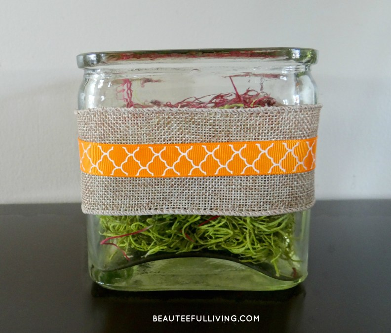 Burlap and ribbon wrapped container