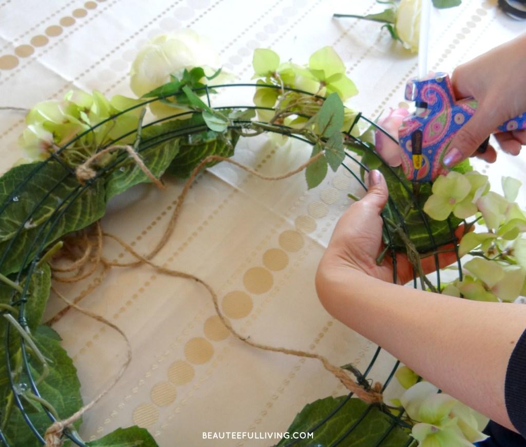 Gluing leaves on wreath