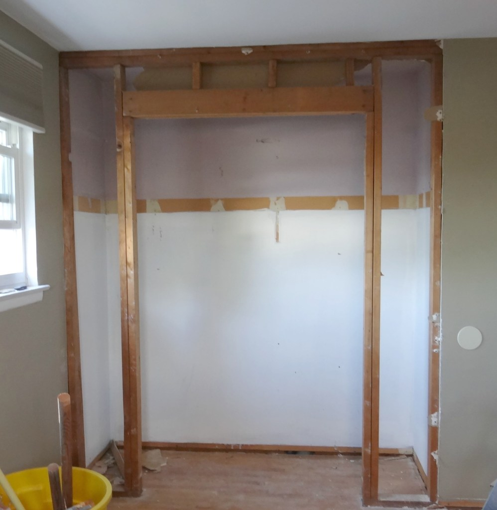 removing-old-closet-frame