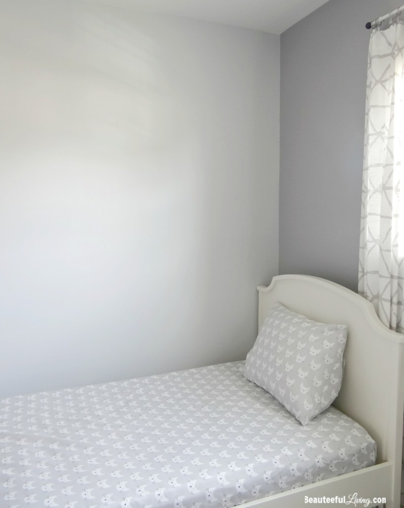 White Twin Bed with sheets