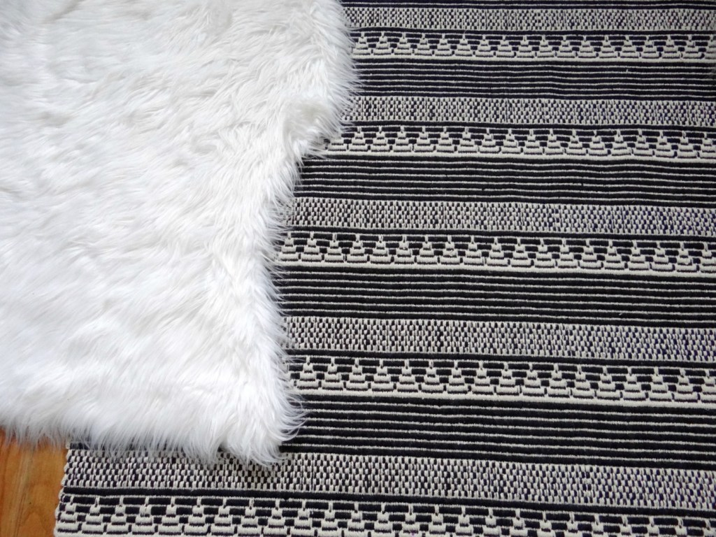 Black and white rug with fur rug