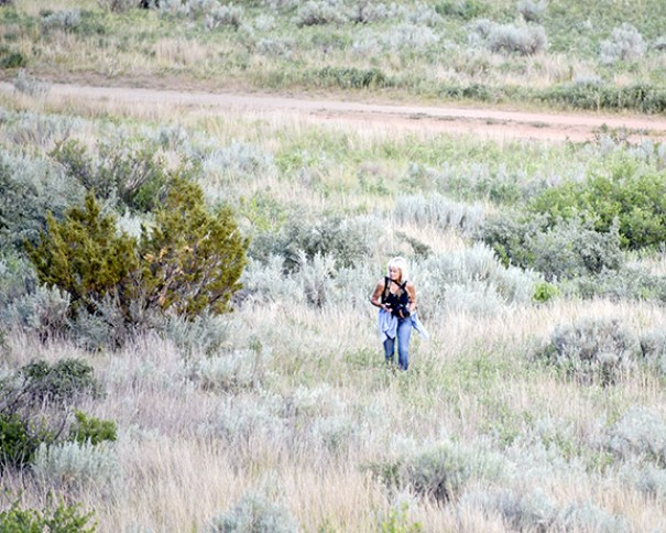 Walking through the sage and brush, she climbed the hill, watching for rattlesnakes.