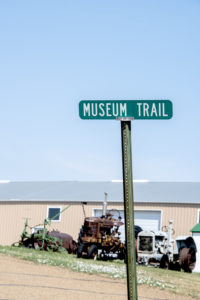 Farm equipment sits outside at the Dunn County Museum