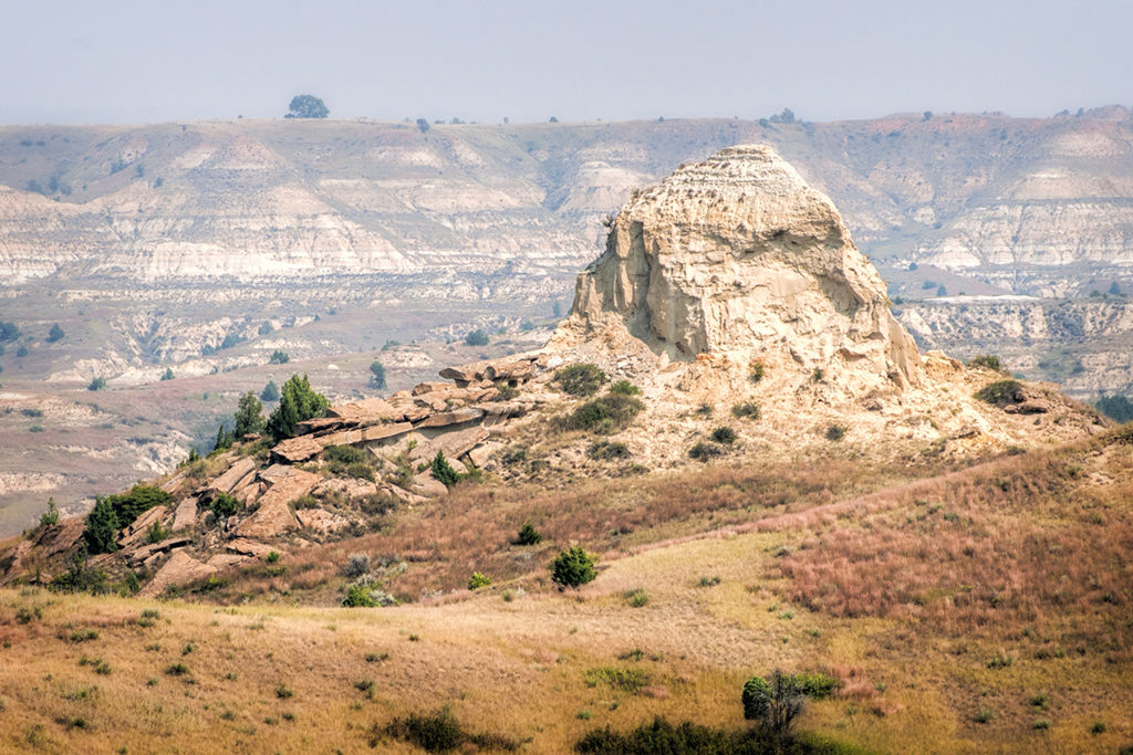 The rough terrain of the North Dakota Badlands includes towering sandstone hills.