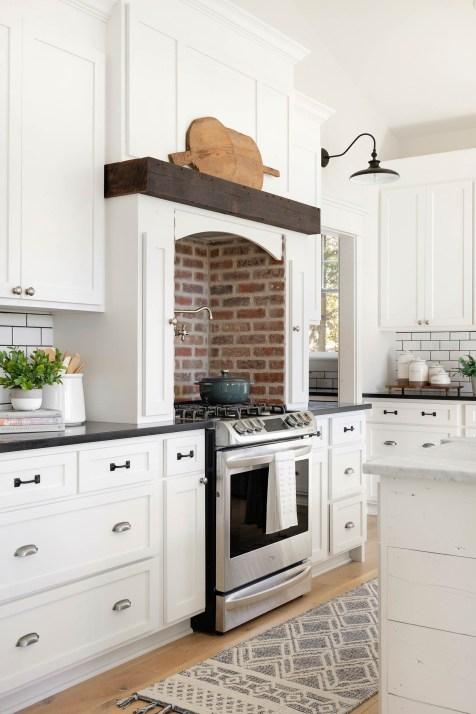 farmhouse kitchen with brick backsplash