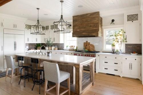 White Farmhouse Kitchen with wooden hood