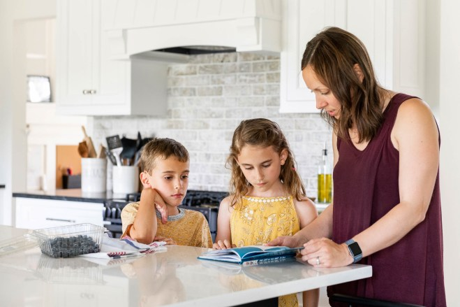 Mom and children in their new modern kitchen renovation