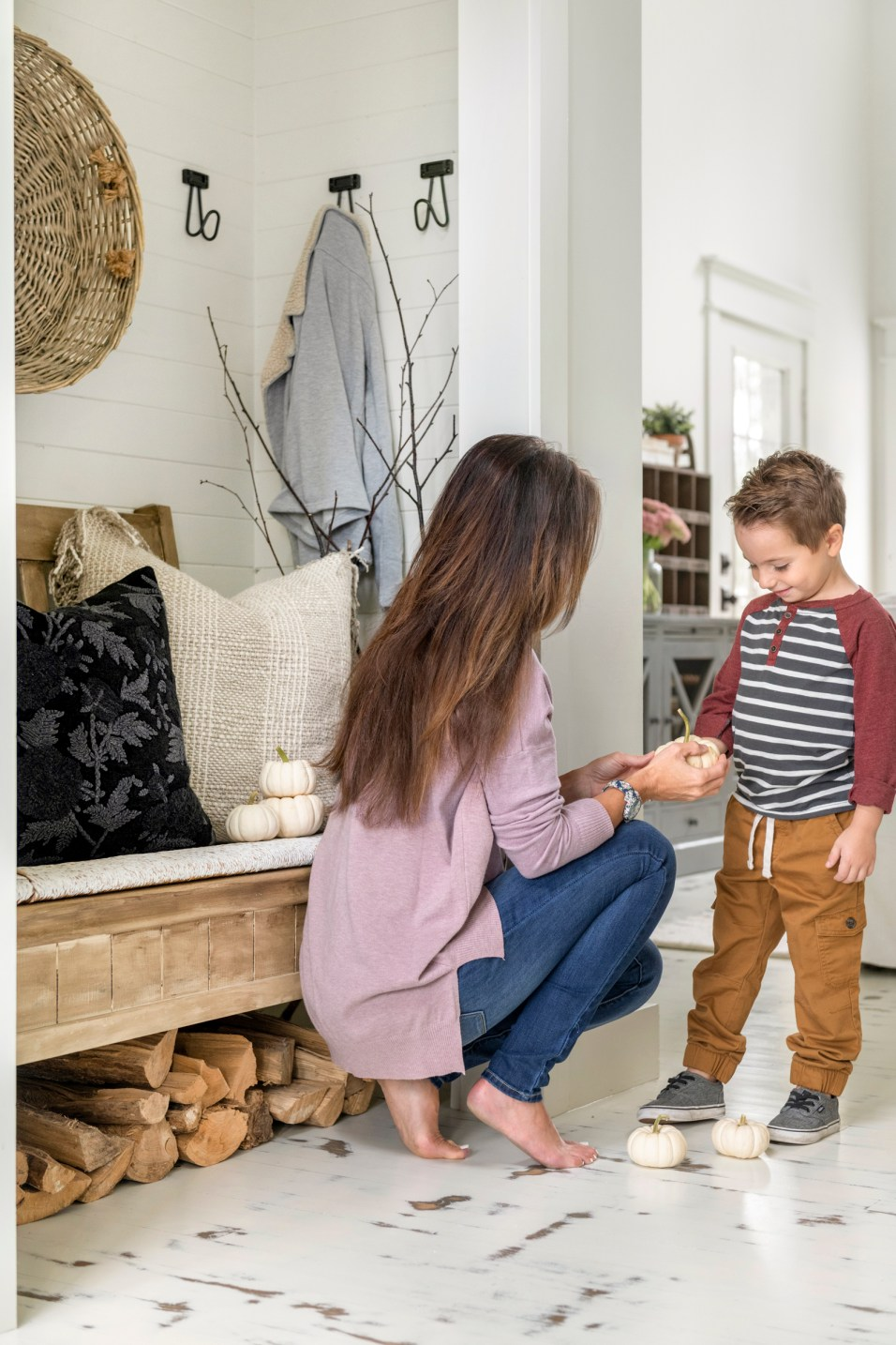 Sarah and her son in their modern white farmhouse