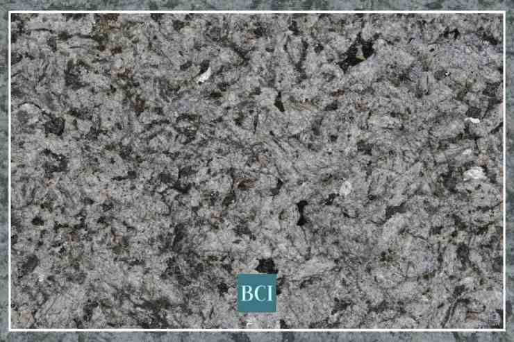 Photo of black and grey flecked granite. Granite is one of the most popular types of stone countertops.