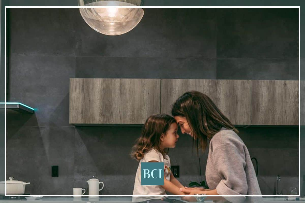 Photo of mom and daughter and the best kitchen countertops for families.