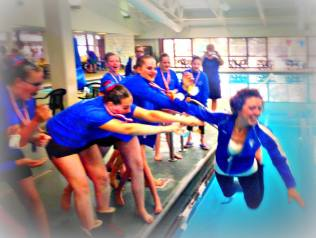My athletes tossing me into the water when they found out they all qualified for nationals!