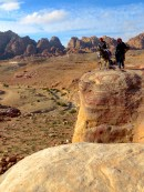 Bedouin Men and donkees relaxing on a cliff above Petra and Wadi Musa - by Anika Mikkelson - Miss Maps - www.MissMaps.com
