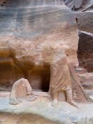 Camel feet and the shephard carved into stone along Petra's Siq - by Anika Mikkelson - Miss Maps - www.MissMaps.com
