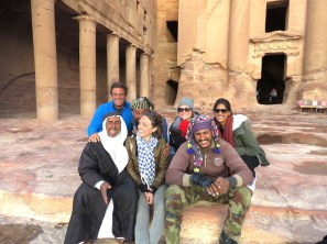 Mohammed of the Mountains and Lost of Petra along with his cousin humor tourists at Petra's Royal Tombs while waiting for sunset - by Anika Mikkelson - MissMaps - www.MissMaps.comMohammed of the Mountains and Lost of Petra along with his cousin humor tourists at Petra's Royal Tombs while waiting for sunset - by Anika Mikkelson - MissMaps - www.MissMaps.com