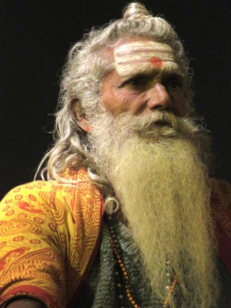 A Hindu Man during a performance of the nightly Ganja in Varanasi India - by Anika Mikkelson - Miss Maps
