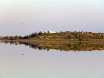Larnaca Airport is near the salt lake, and plane reflections make landings twice as nice - by Anika Mikkelson - Miss Maps - www.MissMaps.com