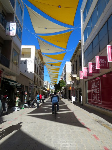 This Biker's Right on Track - biking on Nicosia's main pedestrian street - by Anika Mikkelson - Miss Maps - www.MissMaps.com