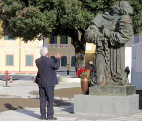 A man stops to pray in front of St Stephen's Catholic Cathedral - Shkoder Albania - by Anika Mikkelson - Miss Maps - www.MissMaps.com