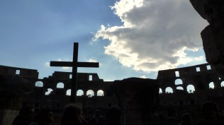 A cross within the Colosseum of Rome Italy - by Anika Mikkelson - Miss Maps - www.MissMaps.com