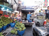 Tossing Lychee in China Town - Bangkok Thailand - by Anika Mikkelson - Miss Maps - www.MissMaps.com