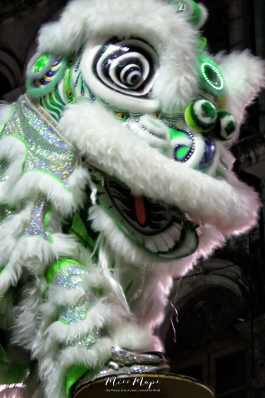 Green Lion Dancers Laughing during Competition - Chinese New Year - Chinatown - Yangon Myanmar - by Anika Mikkelson - Miss Maps - www.MissMaps.com