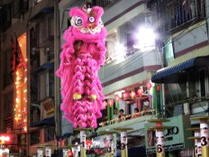 Pink Lion Dancers Lift During Competition - Chinese New Year - Chinatown - Yangon Myanmar - by Anika Mikkelson - Miss Maps - www.MissMaps.com