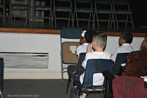 SITTING SCHOOL AT PRESCHOOL GRADUATION